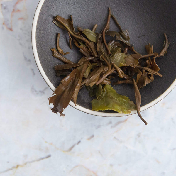 young mountain tea darjeeling copper black tea brewed leaves