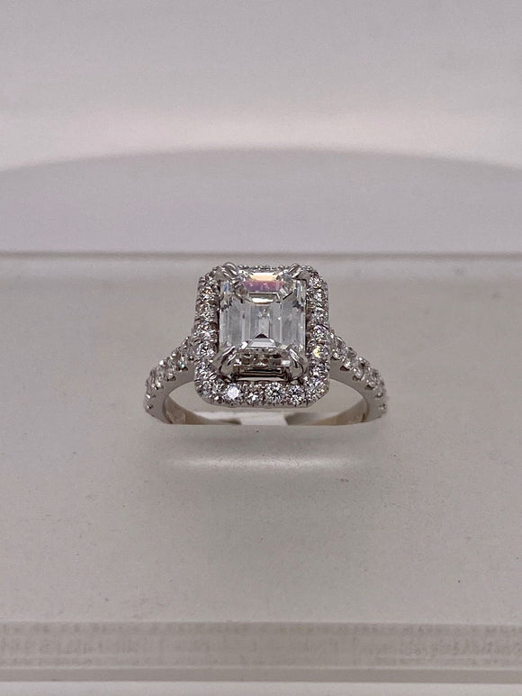 Emerald-Cut Diamond Engagement Ring with Round Diamond Basket