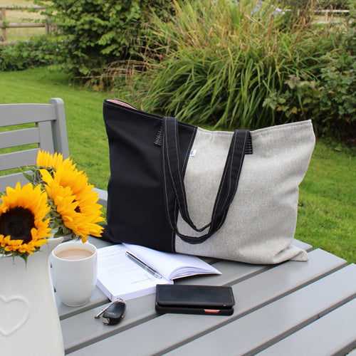Shoulder bag in contrast grey & black soft slouchy fabric