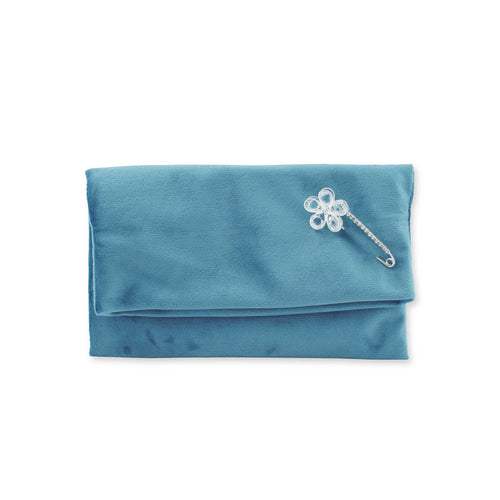 Velvet clutch bag with detachable brooch