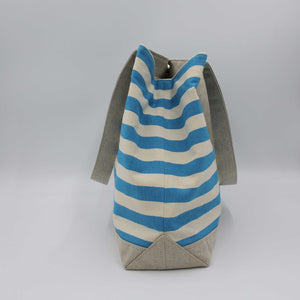 Blue striped beach bag side view