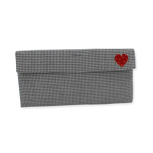 Houndstooth clutch bag with red heart brooch