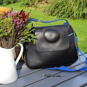 Recycled rubber handbag with puncture repair feature and blue strap