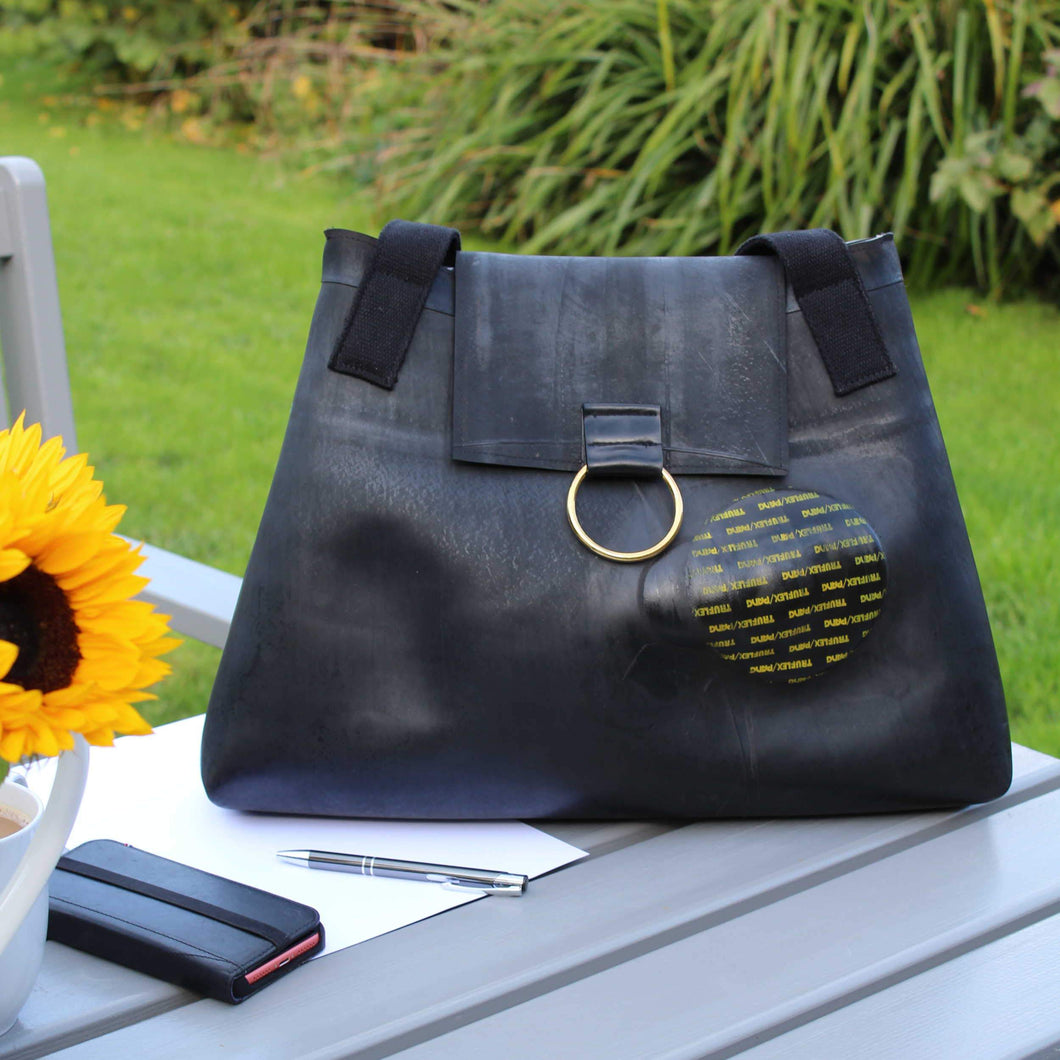 Recycled inner tube bag with a patch