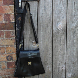 Recycled inner tube crossbody bag with clasp