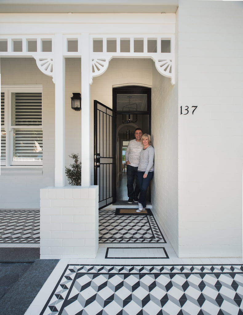 A white Federation home with tessellated verandah tiles