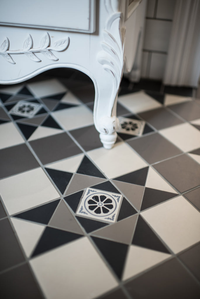 Monochrome tessellated tiles with French Provincial cabinet