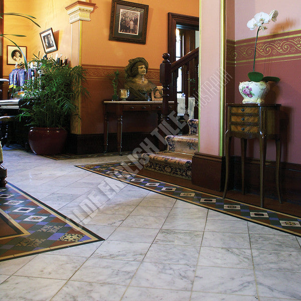 Olde English Tiles –  with the Special custom border. Gorgeous Living Area
