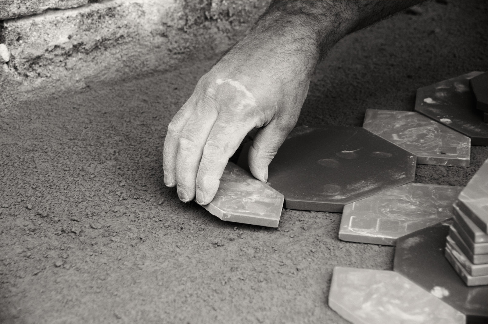 Tessellated Tiler laying tiles in Sydney