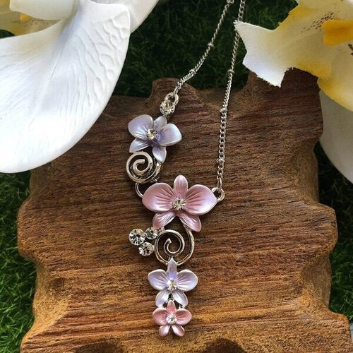 necklace pendant in rhodium plating with dendrobium purple pink orchids from forest jewelry singapore