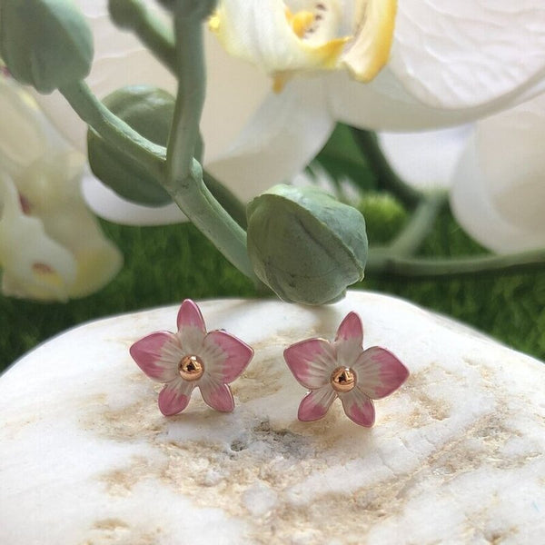 a pair of petite blush pink dendrobium orchid stud earrings in rose gold plating from forest jewelry singapore