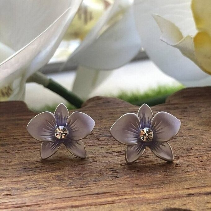 a pair of purple dendrobium orchid stud earrings in rhodium plating from forest jewelry singapore