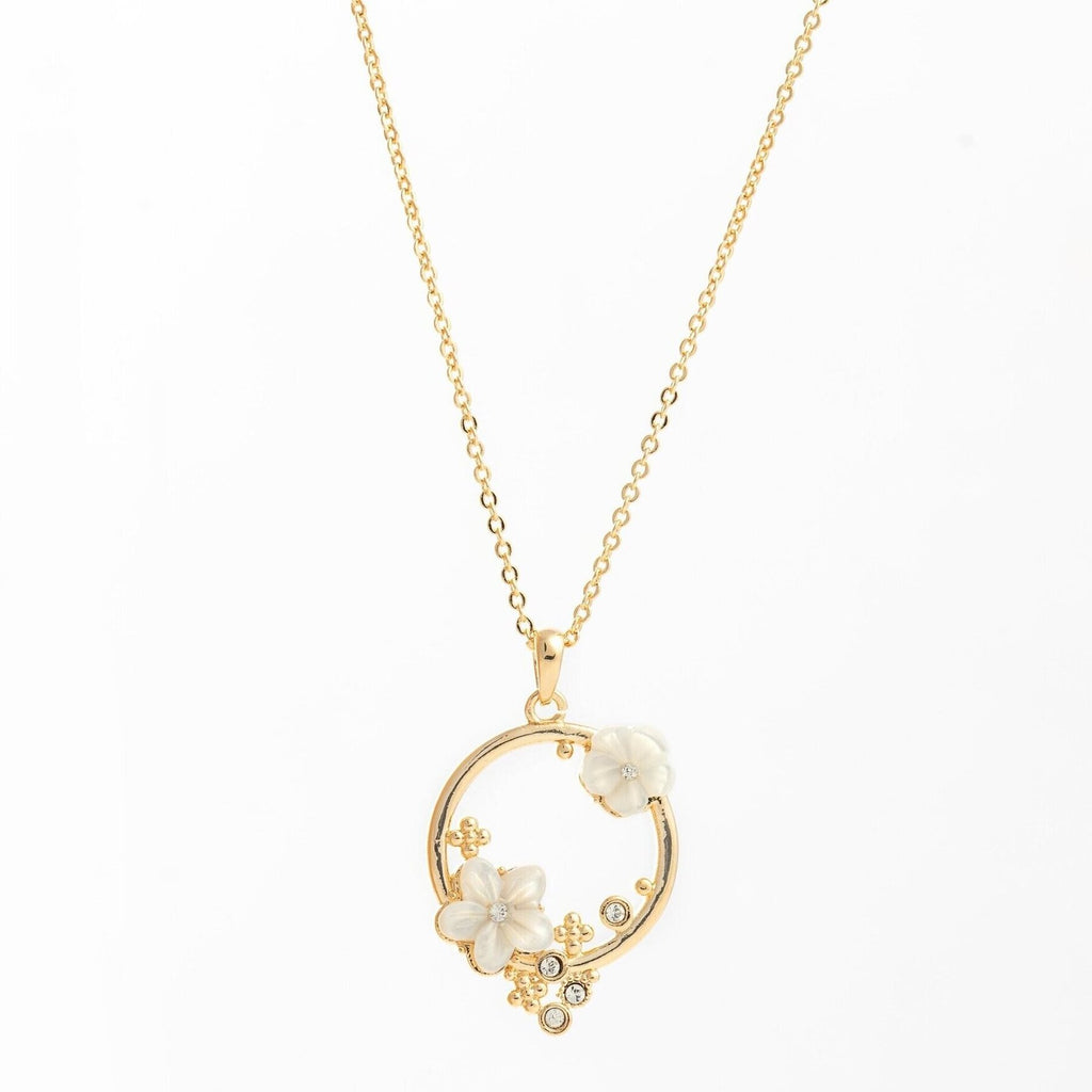 necklace pendant with jasmine petals made from mother of pearl in yellow gold plating from forest jewelry singapore