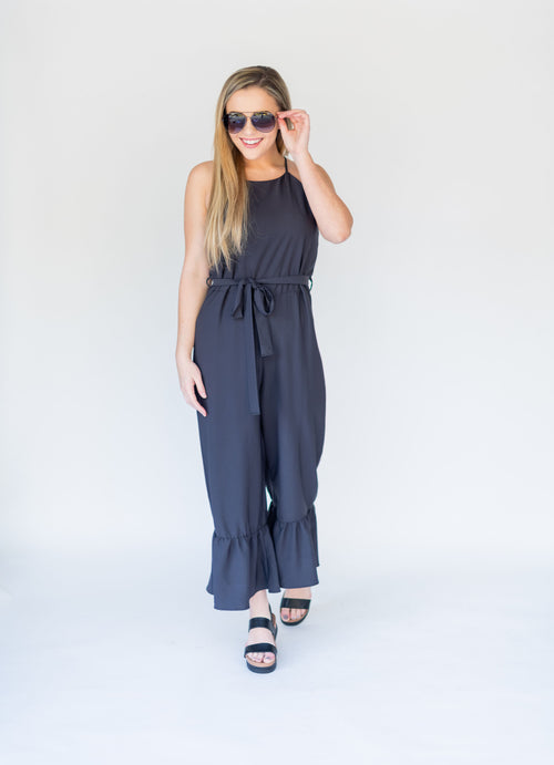Jumping for Joy Jumpsuit with Ruffle Hem and Belt:  Black