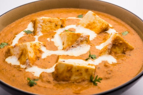 Tofu spiced with tomato onion sauce