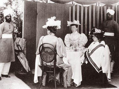 Queen Victoria enjoying a cup of tea with relatives.