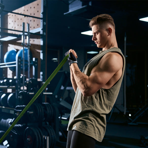 Bodybuilder performing curls with a resistance band