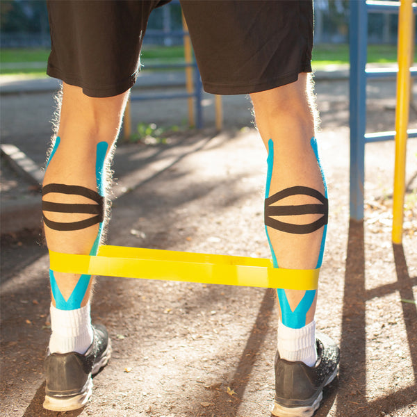 Man rehabilitating injuries with resistance band