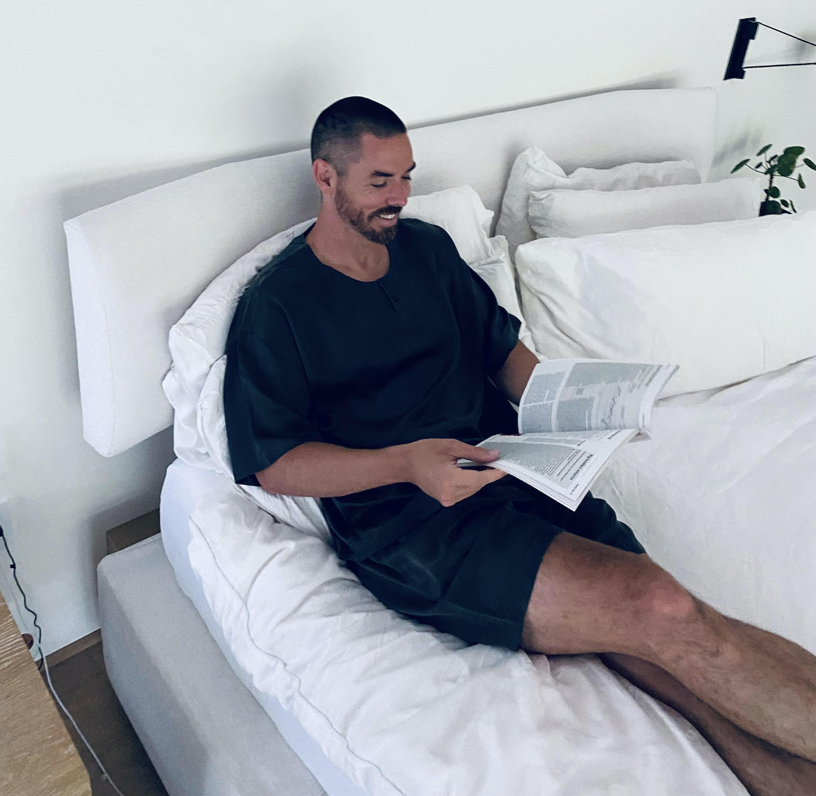 Marc Merrill in bed reading