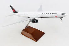 Load image into Gallery viewer, SKR5144 SKYMARKS AIR CANADA 777-300 1/200 W/GEAR & WOOD STAND - SkyMarks Models