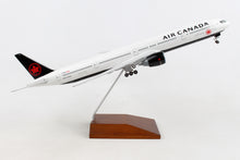 Load image into Gallery viewer, SKR5144 SKYMARKS AIR CANADA 777-300 1/200 W/GEAR & WOOD STAND