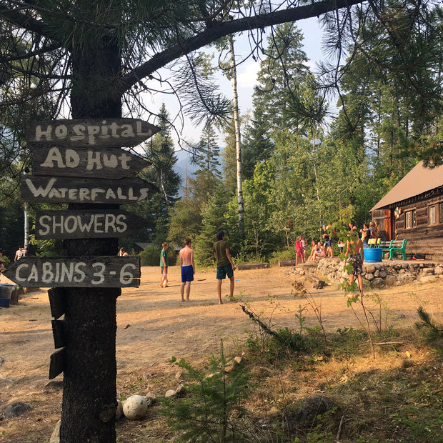 Photo of signs attached to a tree at a camp