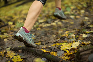 Synchroknit Trail Junkie Closeup running through wooded terrain