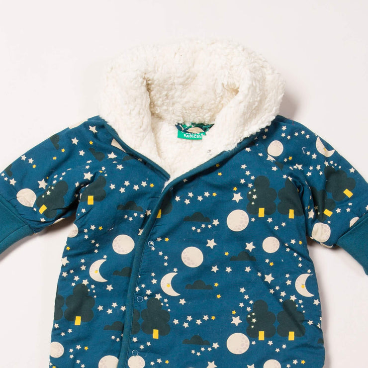 Close up of dark blue baby snowsuiit with sherpa lining, moon and star print