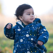 Close up model shot of dark blue baby snowsuiit with sherpa lining, moon and star print