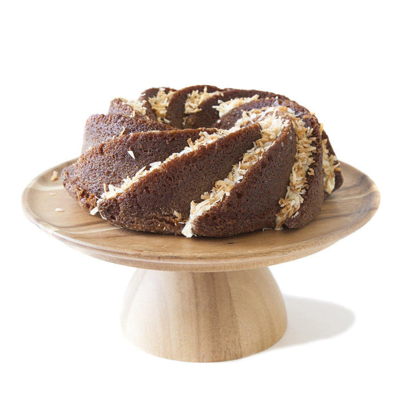 Coconut Bundt Cake Gluten-free on wood cake stand- Krumville Bake Shop