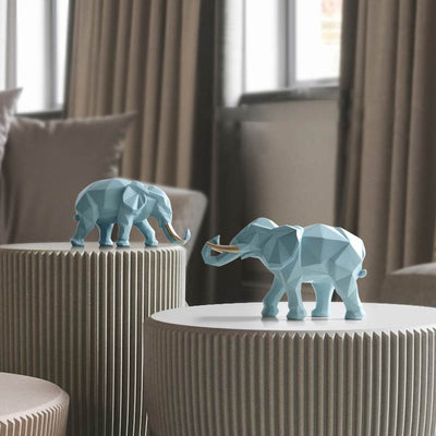 Exemple de decoration des deux statues elephants dans un salon moderne