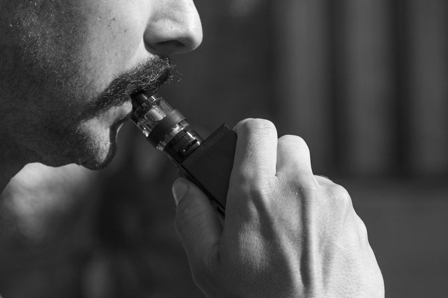 Man vaping e-cigarette