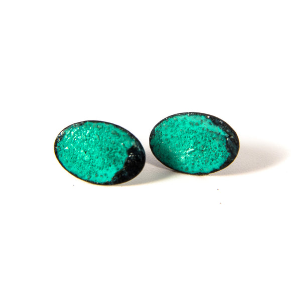 Small oval studs with green patina over brass