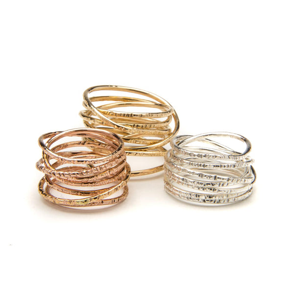 hammered coil rings in golds and silver