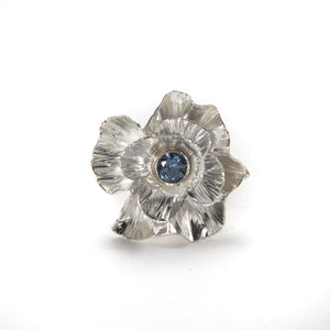 Sterling silver ring hand forged and heavily textured  with faceted blue sapphire