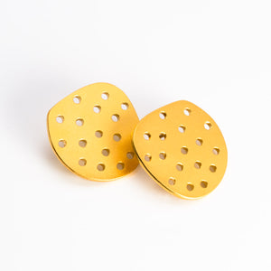 Perforated Circle Earrings in Gold Plated Steel. Sterling silver ear wires.