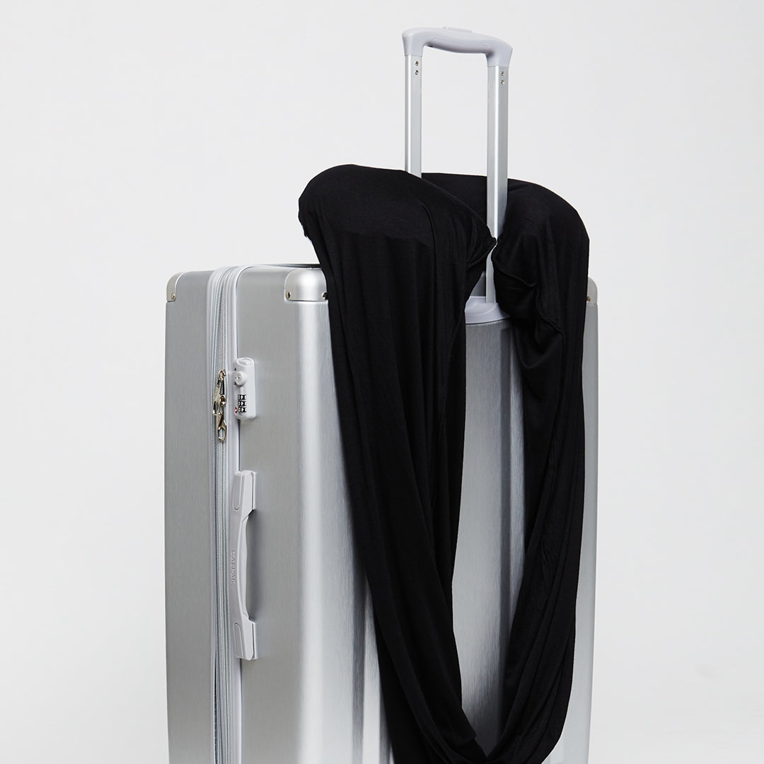 Sleeper Scarf draped over luggage