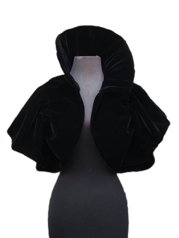 A cute short bolero jacket made out of black velour fabric. Add this bolero to any outfit for some extra style!  Bolero is one size, drapes over the shoulders, has a long thick collar, and stretchy armholes to fit any body type!