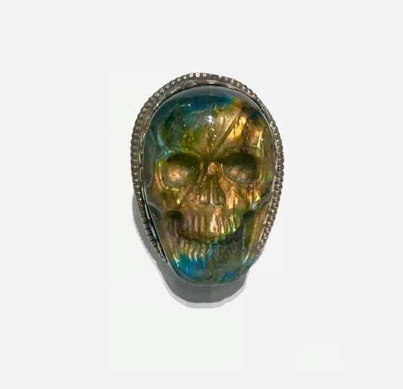 Adjustable brass ring adorned with hand carved colorful labradorite skull