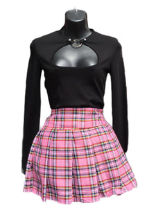Primarily bright pink tartan skirt with elements of red, yellow, white and black
