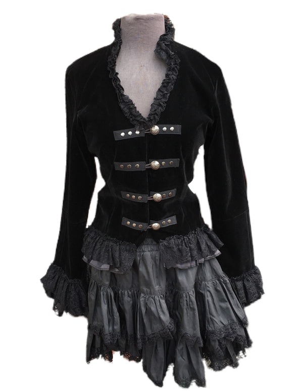 A cute cropped hoodie made of a beautiful black velvet with a decorative tie at the neck.