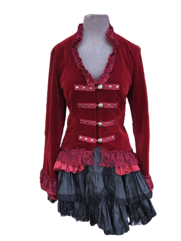 This red velvet tailcoat comes with silver buttons in front and an adjustable back just in case you want to cinch that waistline!
