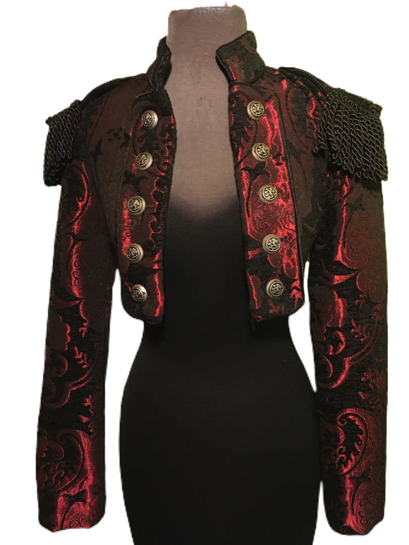 European cut, women's formal riding jacket. Beautiful short jacket with a stand-up collar made in rich tapestry fabric. Ten medieval lion buttons fasten front lapels which also can be unbuttoned and worn crossing over in double-breasted style. Matching smaller buttons fasten cuffs. Ornate bullion fringe epaulets add an authoritarian vibe. Lined in rich black satin. Wonderful!  Measurements:  Small Ð Chest 34-36_ Shoulders (from shoulder seam to shoulder seam across upper back) 15_