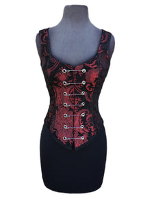 A Shrine classic!! A heavily constructed corset top in rich red and black tapestry fabric with a great form fit. Heavy metal boning at sides and lycra stretch panel at back adds extra strong support. Fastens in front with seven large kilt pins but also zips in back for easy access. Rich black satin piping around armholes and neckline and black satin lining inside. Trimmed at the bottom with black braid. This is one of our favorites! A very flattering fit!