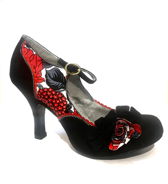 Pin up style with red and black floral decorations and faux black rose accents