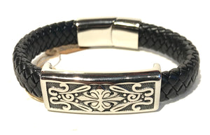 Decorative and flourished flat faced stainless steel cross decoration with leather woven band