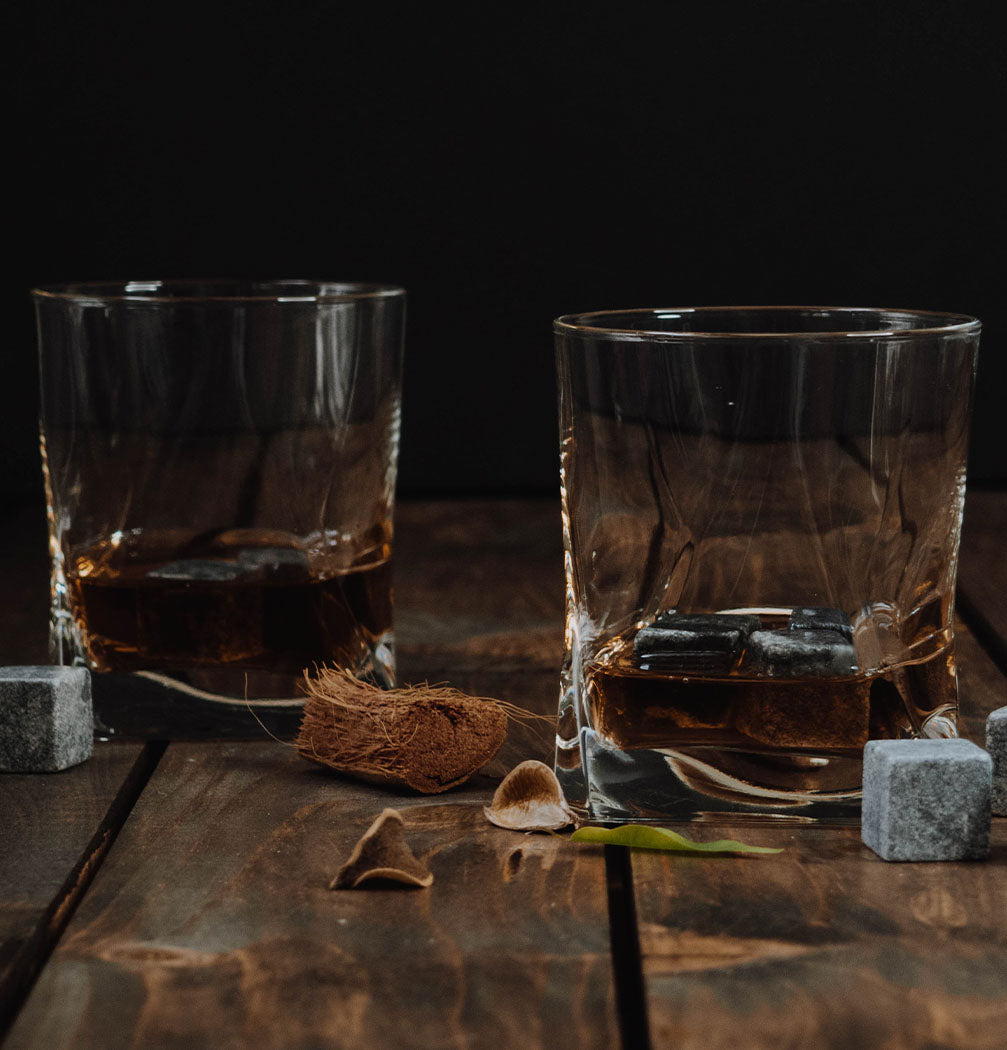 two cups filled with bourbon