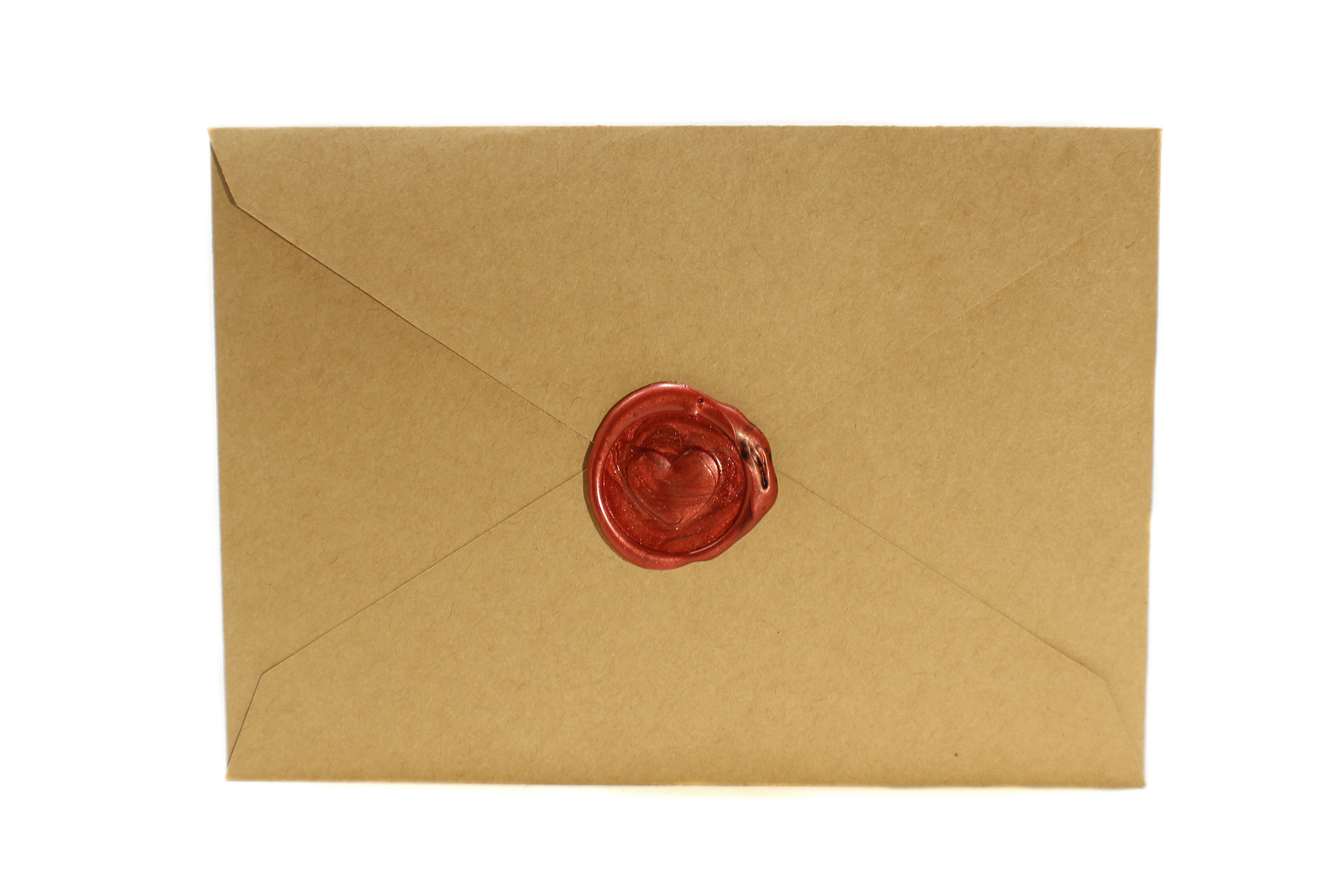 a few burnt hairs dungeons and dragon front shot of brown kraft envelope with red heart style wax seal