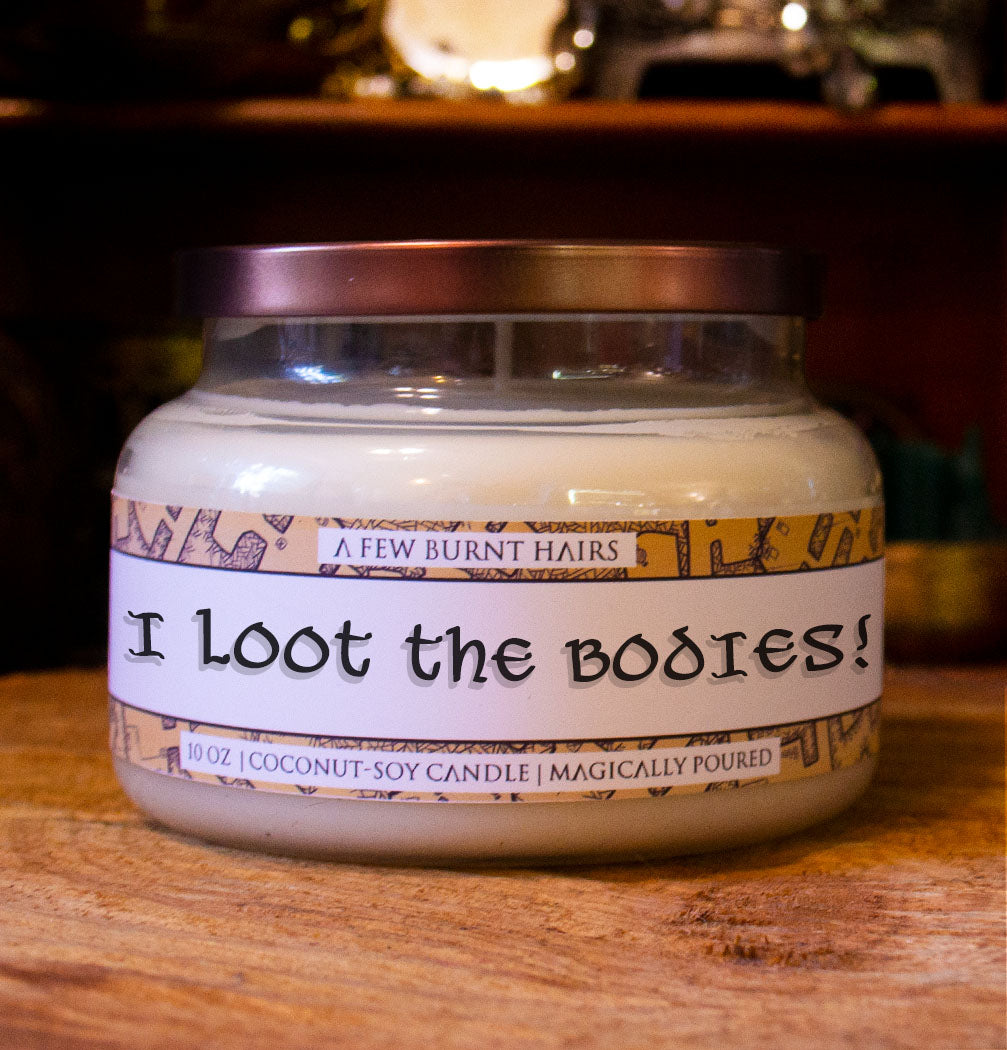 "close up of cylindrical candle ""i loot the bodies!"""