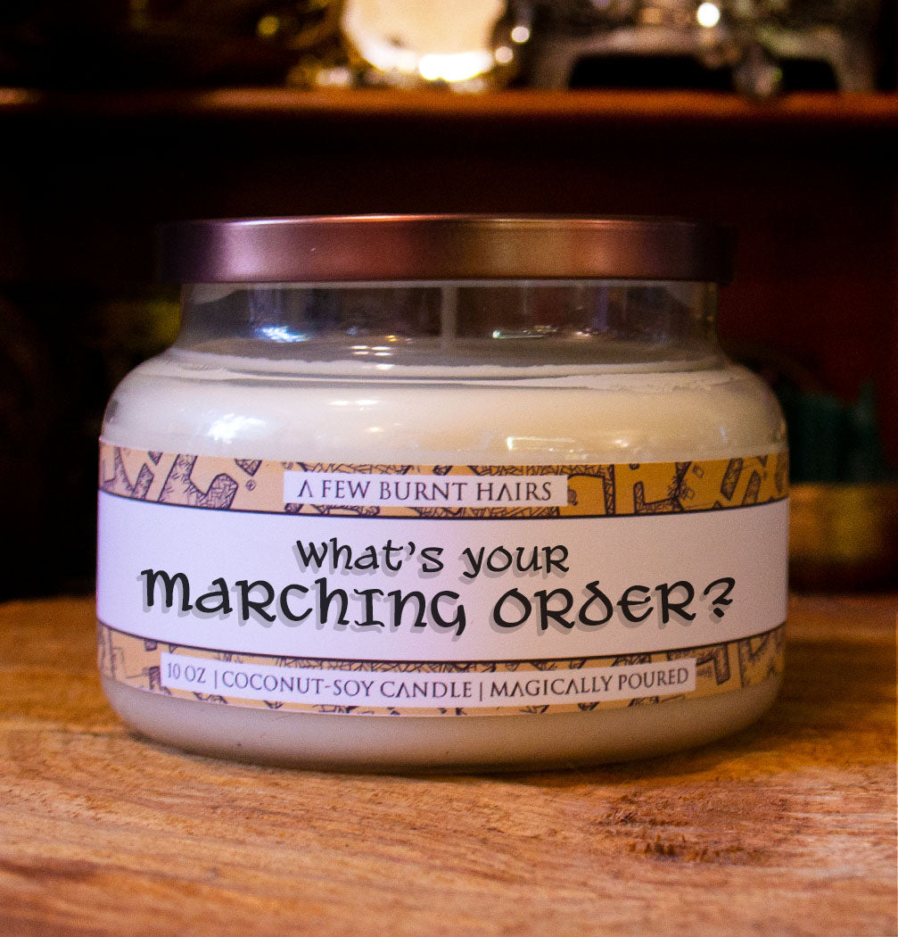 "close up of cylindrical candle ""what's your marching order?"""